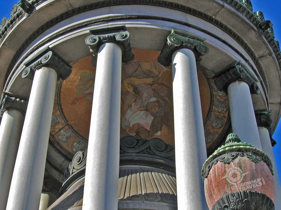 Architectural details like columns and domes enhance the structures