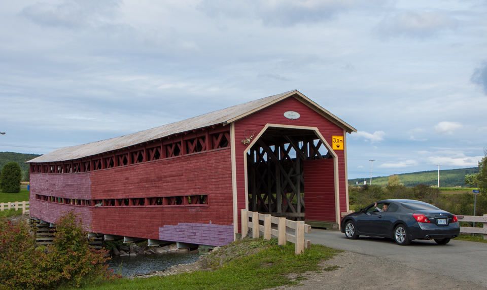 Driving across one of many covered bridges in New Brunswick