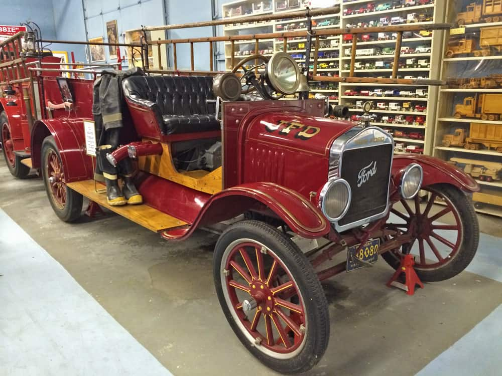 60 antique and vintage fire trucks fill garage after garage of the museum.