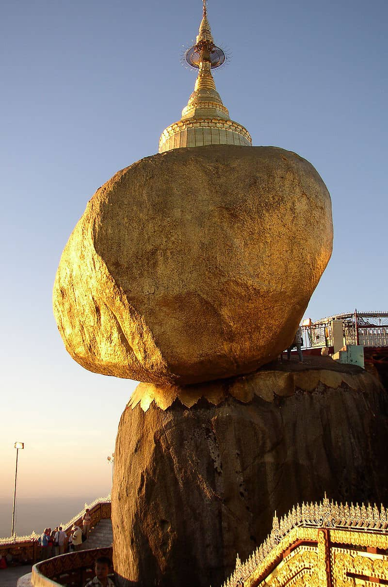 Covered in actual gold leaf, this golden rock is one of the most sacred Buddhist sites in the country. Photo: Ralf-André Lettau