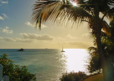 sunset with sailboat on island of Antigua