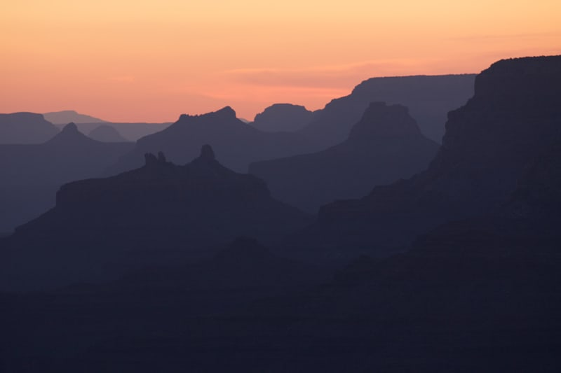 sunset on the buttes of the Grand Canyon