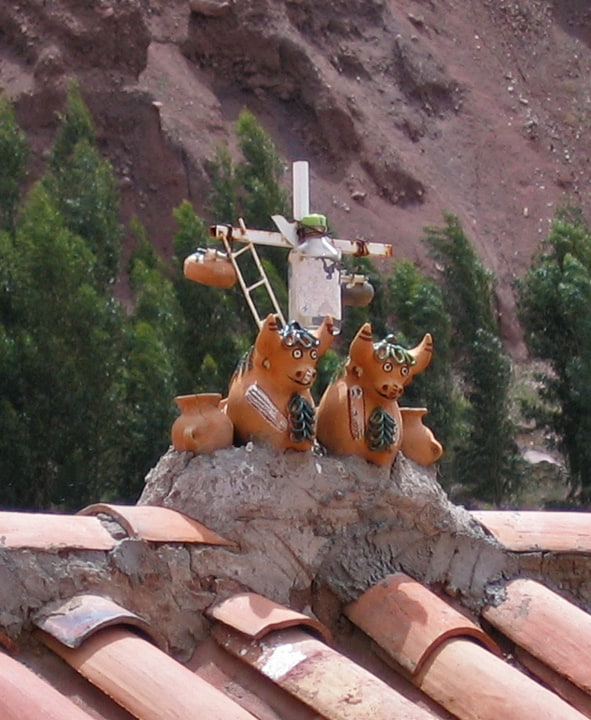 iconic bulls and cross on Peruvian rooftop