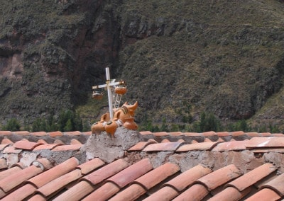 bulls and cross artifact on rooftop Peru