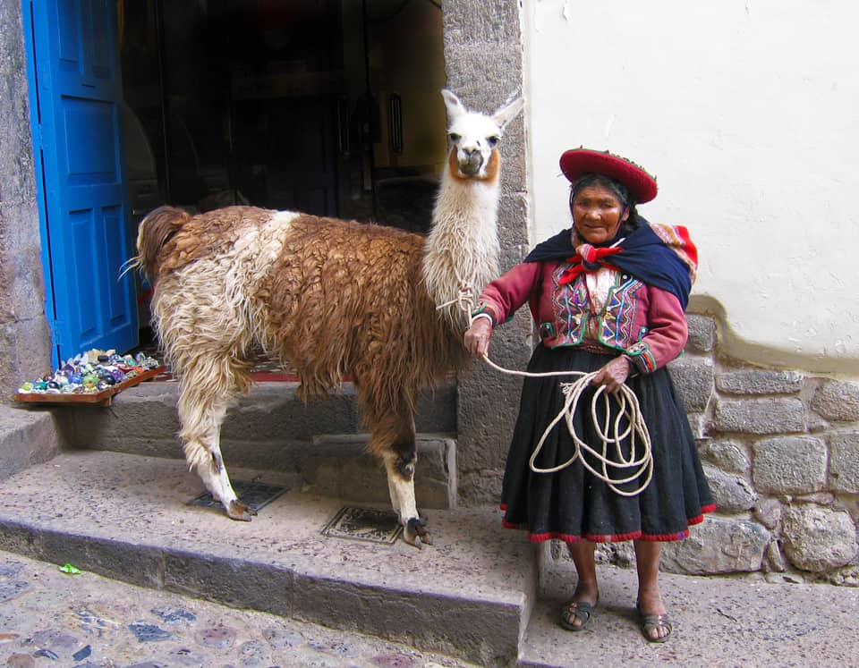 Peru Cusco llama and woman