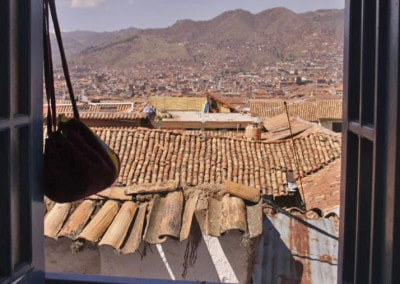 Cusco rooftops seen from balcony window