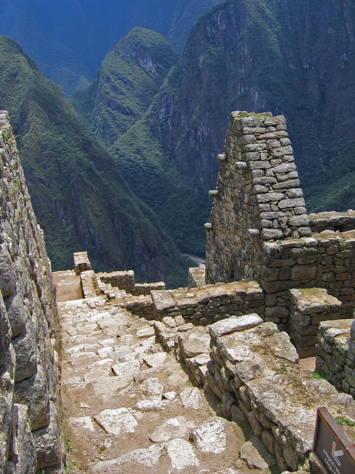 steep staircase descending to cliff edge on Machu Picchu Peru