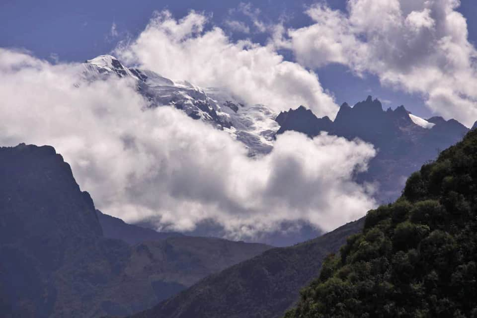 Clouds on snowy Andes Inca Trail