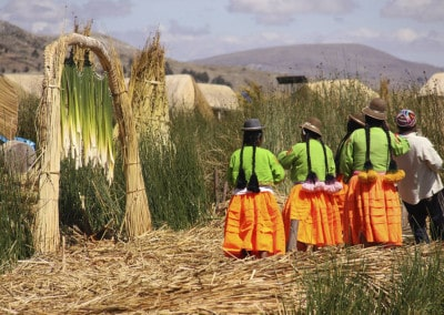 Uros Ladies in colourful costumes Lake Titicaca Peru