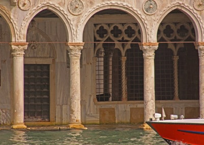 Venice red boat bow flooded palazzo