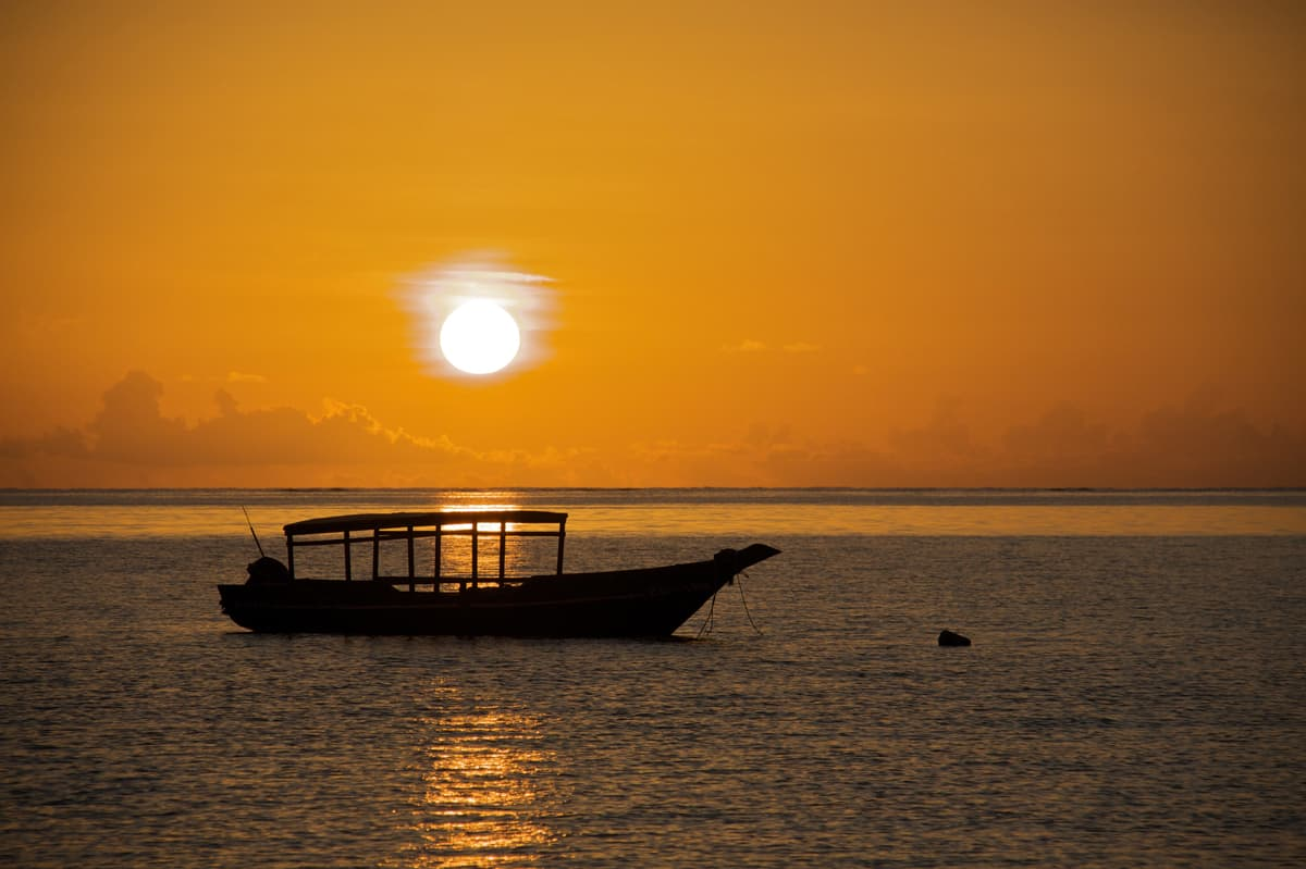 Zanzibar sunset Pongwe beach with silhouetted boat