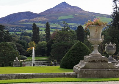 view over formal gardens with stone urn Ireland