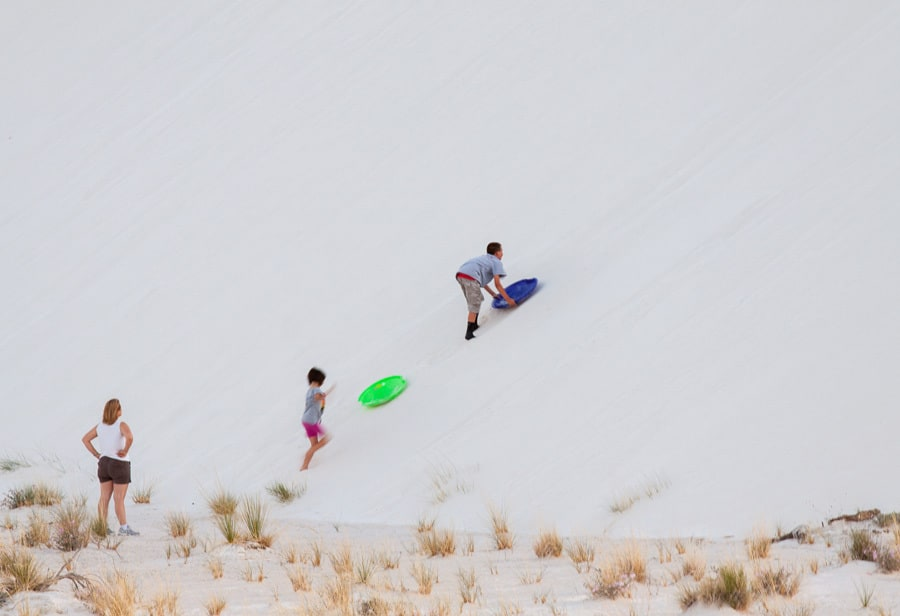 Kids can borrow saucers from the Park's Visitor Centre to slide down the dunes.