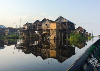 Inle Lake stilt house reflection