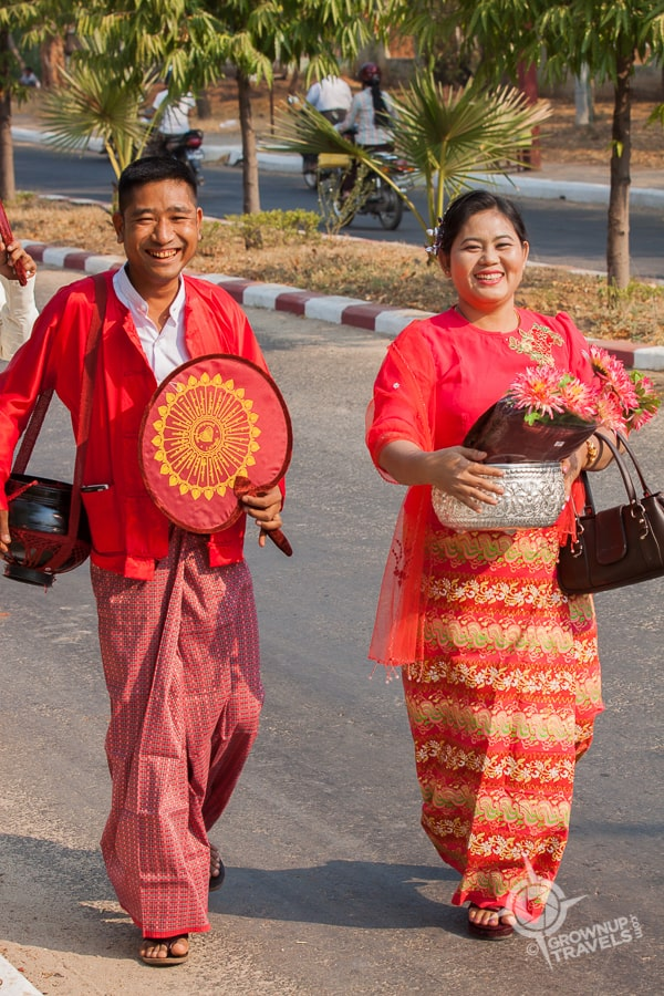 Zaw Zaw and his wife proudly leading their son's ordination parade