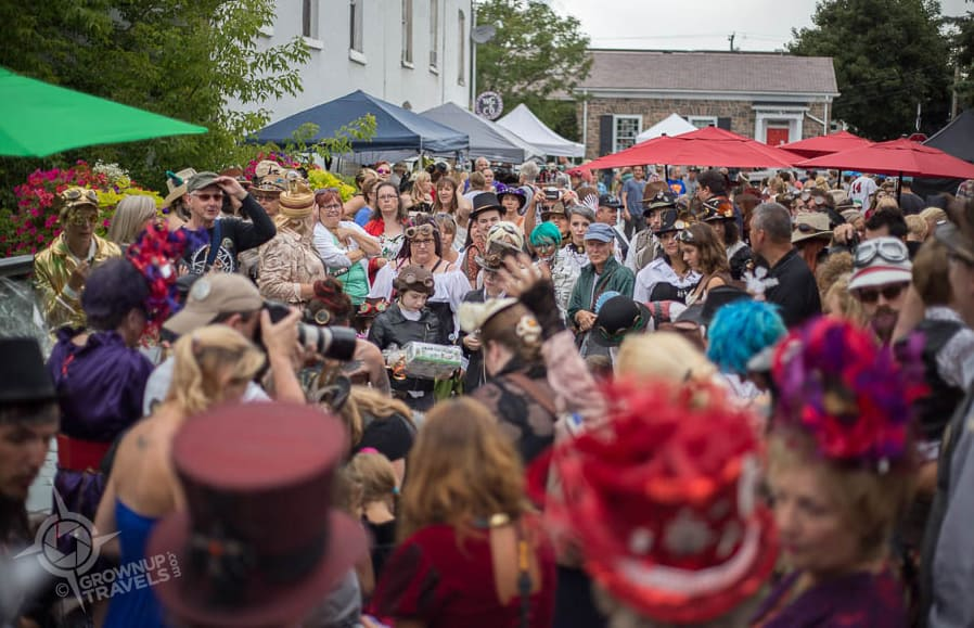 Steampunkers crowd onto the bridge in Downtown Coldwater during the 2015 Festival
