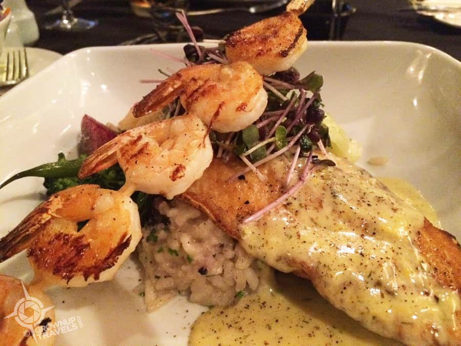 Lake trout and shrimp over risotto with a lemon dill sauce from Grape and Olive Wine Bar and Bistro.