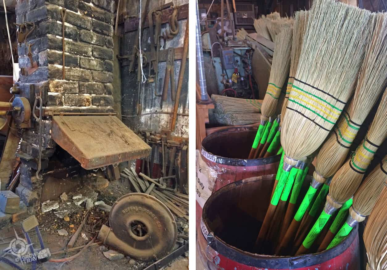 The old forge furnace and just-made brooms at Hamel Brooms Co.
