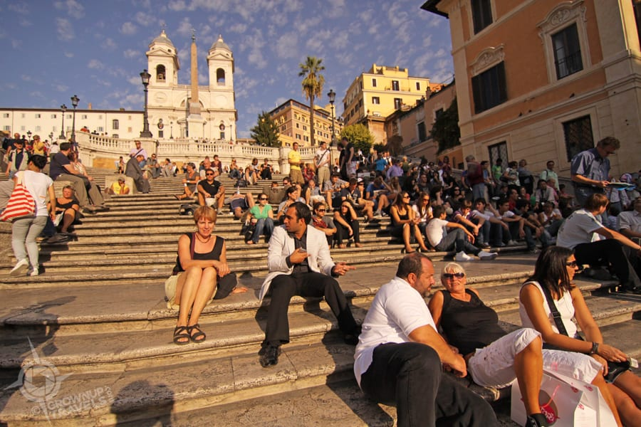 Piazza di Spagna's famous steps are a favourite hangout for Italian men trying to meet foreign women. Can you spot the wannabe 'pick up artist' in this shot?