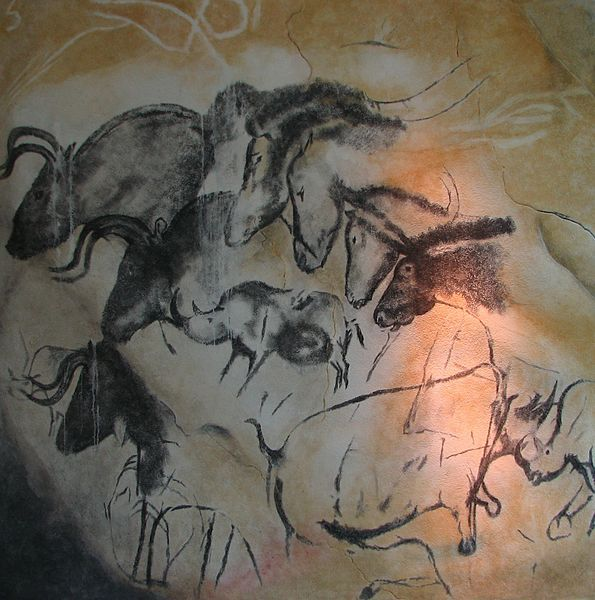 A group of lions on the far walls of the Chauvet cave