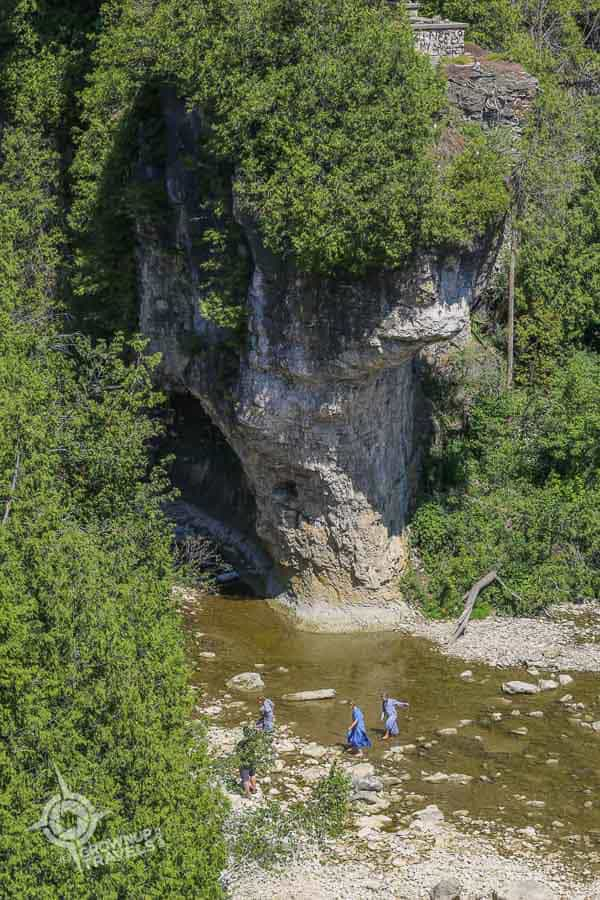 Young Mennonite girls wading at the bottom of the Elora Gorge