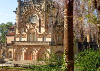 Wisteria-covered walkway and view of Bussaco Palace Portugal