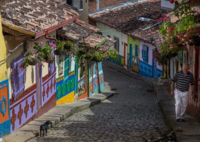 Guatape colourful streets dog walker