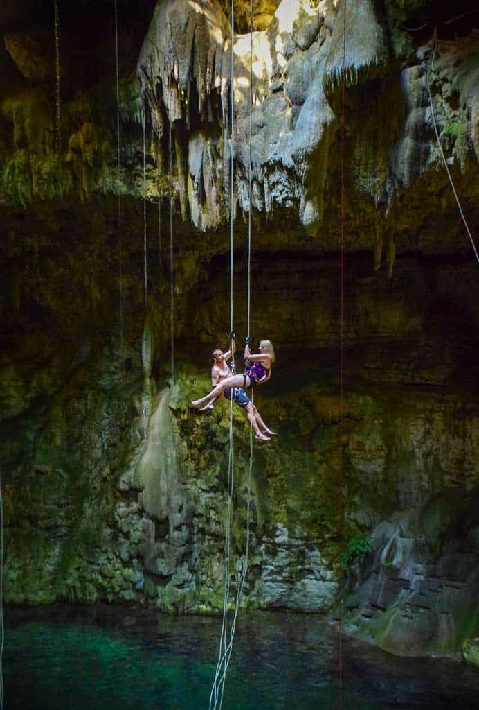 Jane Henk scissors over Cenote Maya