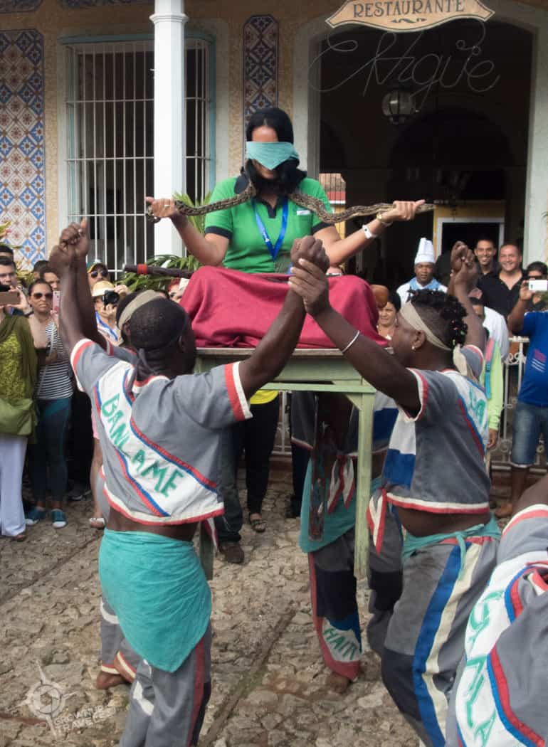 Ritualistic dance performance with snake in Trinidad Cuba