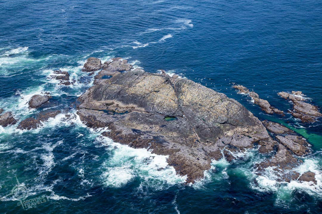 islet offshore in Tofino with person