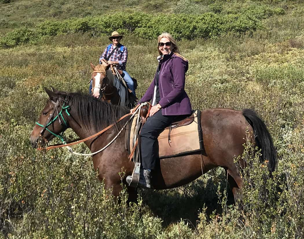Jane and Henk on horseback in Tombstone