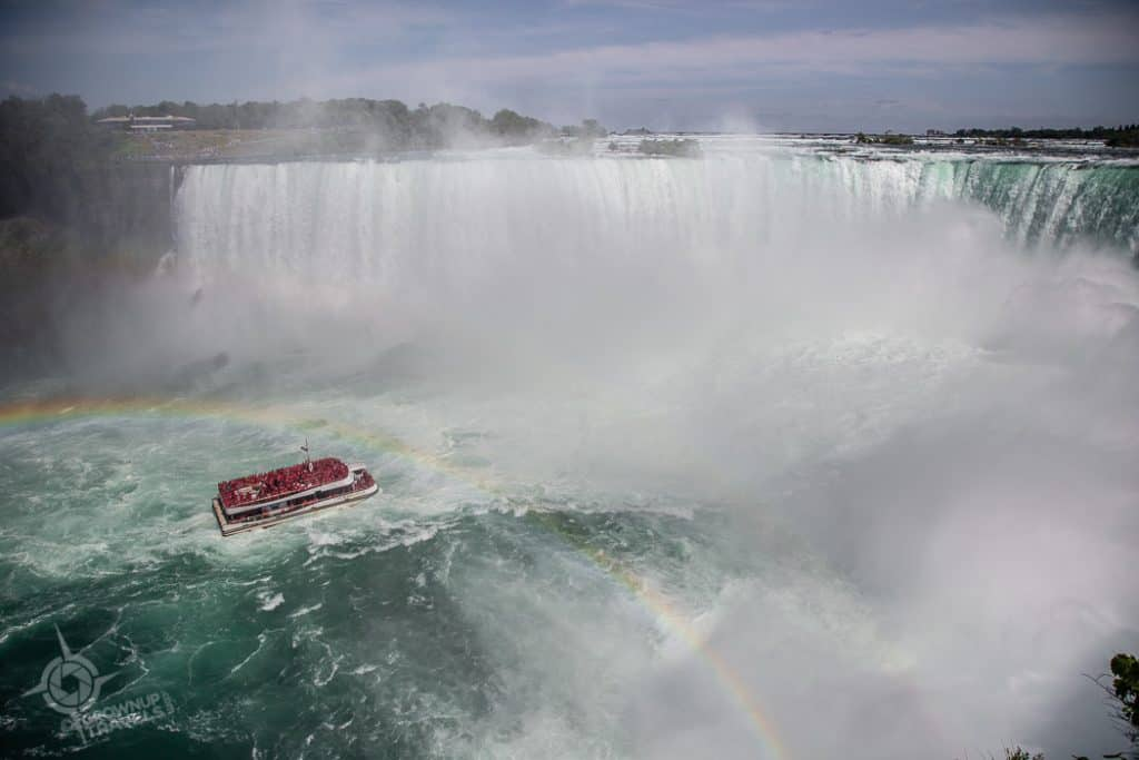 Hornblower in the mist of Niagara Falls with rainbow