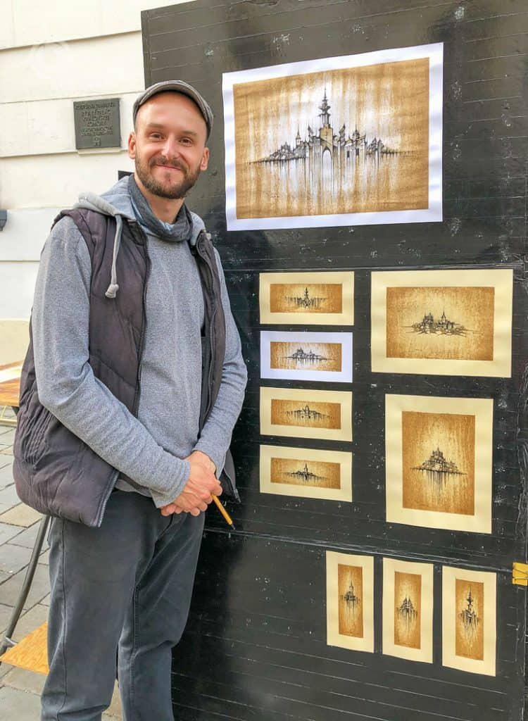 Street Artist with coffee paintings Bratislava Old Town