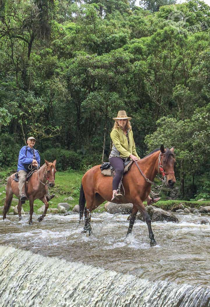 Crossing waterfall in Cocora valley Colombia